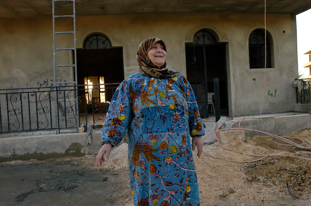 Salima Barakat who is reconstructing her house after it was destroyed in the 2006 Hezbollah-Israel conflict. When cleaning up the rubble following the war she was injured by a cluster bomblet when it exploded. Millions of cluster sub-munitions and other remnants of war lay scattered across southern Lebanon..Yohmour, Lebanon. 25/11/2008..Photo © J.B. Russell