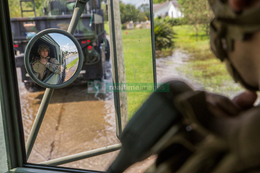 U.S. Marine Corps Cpl. KC Arellano, diesel mechanic with Detachment Bravo, Marine Wing Support Squadron 473, Marine Air Craft Group 41, 4th Marine Aircraft Wing, Marine Forces Reserve, looks out of a 7-ton truck at the flooded streets of Orange, Texas, Sept. 3, 2017. Hurricane Harvey landed in eastern Texas on Aug. 25, 2017, flooding thousands of homes and displacing over 30,000 people. (U.S. Marine Corps photo by Lance Cpl. Niles Lee)  Please note: Fees charged by the agency are for the agency's services only, and do not, nor are they intended to, convey to the user any ownership of Copyright or License in the material. The agency does not claim any ownership including but not limited to Copyright or License in the attached material. By publishing this material you expressly agree to indemnify and to hold the agency and its directors, shareholders and employees harmless from any loss, claims, damages, demands, expenses (including legal fees), or any causes of action or allegation against the agency arising out of or connected in any way with publication of the material.
