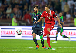 BELGRADE, SERBIA - Sunday, June 11, 2017: Wales' Joe Allen and Serbia's Namanja Matic during the 2018 FIFA World Cup Qualifying Group D match between Wales and Serbia at the Red Star Stadium. (Pic by David Rawcliffe/Propaganda)
