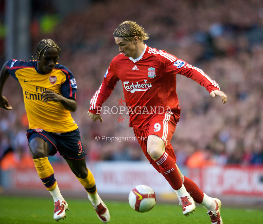 LIVERPOOL, ENGLAND - Tuesday, April 21, 2009: Liverpool's Fernando Torres and Arsenal's Bacary Sanga during the Premiership match at Anfield. (Photo by David Rawcliffe/Propaganda)