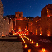 Traditional farolitas (or luminarias) adorn the ruins of San Jose de los Jemez Mission Church near Jemez Springs, NM