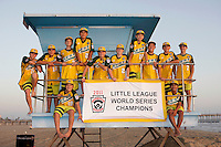 26 September 2011: 2011 Little League Baseball World Series Championship team portrait northside of the Huntington Beach Pier at sunset in Southern California.  Ocean View team WEST beat Hamamtsu City, Japan, 2-1, to become the seventh team from California to win the title on August 28, 2011 in South Williamsport, PA. In Photo: Furry, Takada, Windisch, Cianca, Kotkosky, Mayorga, Palmer, Anderson, Catano, Danner, Pratto, Martinez.