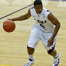 January 2, 2012; Baton Rouge, LA; LSU Tigers guard Chris Bass (4) against the Virginia Cavaliers during the second half of a game at the Pete Maravich Assembly Center. Virginia defeated LSU 57-52.  Mandatory Credit: Derick E. Hingle-US PRESSWIRE