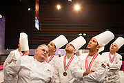 Des patissiers prennent connaissance du classement des laureats lors de la Coupe du Monde de Patisserie, Salon Sirha, Lyon, janvier 2015.