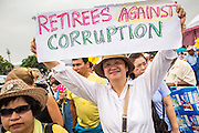 24 NOVEMBER 2012 - BANGKOK, THAILAND: A woman marches around a large anti government, pro-monarchy, protest  on November 24, 2012 in Bangkok, Thailand. The Siam Pitak group, which sponsored the protest, cited alleged government corruption and anti-monarchist elements within the ruling party as grounds for the protest. Police used tear gas and baton charges againt protesters.       PHOTO BY JACK KURTZ