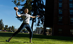 Macey Schlittler '16, tosses a football on a warm spring day at PLU on Thursday, April 16, 2015. (Photo: John Froschauer/PLU)