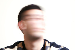 Blurred portrait of a young man; model released for use in HIV and Aids,
