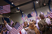 04 JULY 2012 - PHOENIX, AZ:  ISRAEL NEVAREZ (left), originally from Mexico, MAI ALI, and OMAR YUSUF, both originally from Somalia, cheer after becoming US citizens Wednesday. About 250 people, from 62 countries, were naturalized as US citizens during the 24th Annual Fiesta of Independence naturization ceremony at South Mountain Community College in Phoenix Wednesday. The ceremony was presided over by the Honorable Roslyn O. Silver, Chief United States District Court Judge.   PHOTO BY JACK KURTZ