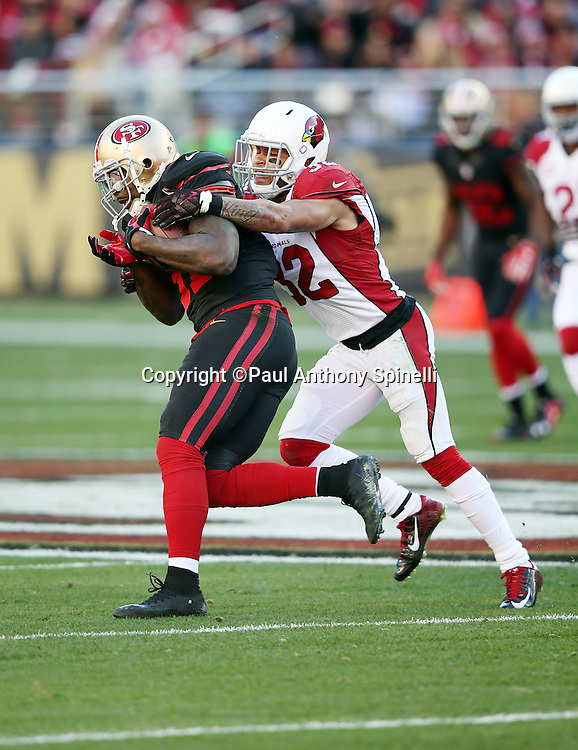 San Francisco 49ers wide receiver Anquan Boldin (81) looks for yardage after the catch as he catches a late second quarter pass for a gain of 15 yards and a first down as he gets tackled by Arizona Cardinals free safety Tyrann Mathieu (32) during the 2015 week 12 regular season NFL football game against the Arizona Cardinals on Sunday, Nov. 29, 2015 in Santa Clara, Calif. The Cardinals won the game 19-13. (©Paul Anthony Spinelli)