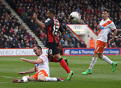 Blackpool's Tom Aldred tackles Bournemouth's Callum Wilson - Photo mandatory by-line: Robbie Stephenson/JMP - Mobile: 07966 386802 - 14/03/2015 - SPORT - Football - Bournemouth - Dean Court - AFC Bournemouth v Blackpool - Sky Bet Championship