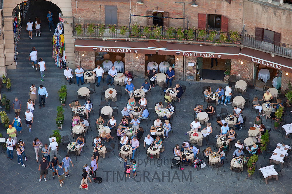 Aerial view from Il Torre clock tower of diners at Bar Il Palio in Piazza del Campo, Siena, Italy