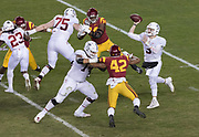 SANTA CLARA, CA - DECEMBER 1:  K.J. Costello #3 of the Stanford Cardinal attempts a pass during the Pac-12 Championship game against the USC Trojans on December 1, 2017 at Levi's Stadium in Santa Clara, California.   Other visible players include Rasheem Green #94 and Uchenna Nwosu #42 of USC; Trevor Speights #23, Devery Hamilton #74, and A. T. Hall #75 of Stanford.  (Photo by David Madison/Getty Images)