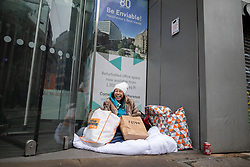 © Licensed to London News Pictures . 25/12/2018 . Manchester , UK . Homeless woman NUT SANGKHAN (45) on Mosley Street . Homeless people sleeping rough on the streets of Manchester City Centre on Christmas Day . Photo credit : Joel Goodman/LNP