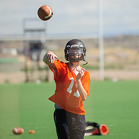 080404       Adron Gardner<br /> <br /> Gallup Bengal Dominick Stewart (11) throws a short pass during football practice at Gallup High School in Gallup Monday.