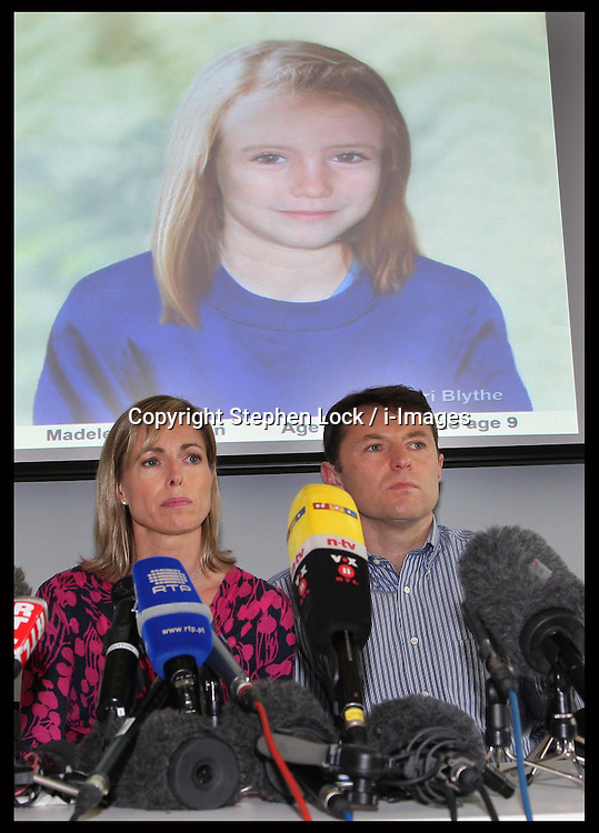 Kate McCann and Gerry McCann with the  latest  computer generated picture of Madeleine McCann at a  press conference in London, to mark the 5th anniversary  of their  daughter's disappearance, Wednesday, 2nd May 2012.  Photo by: Stephen Lock / i-Images