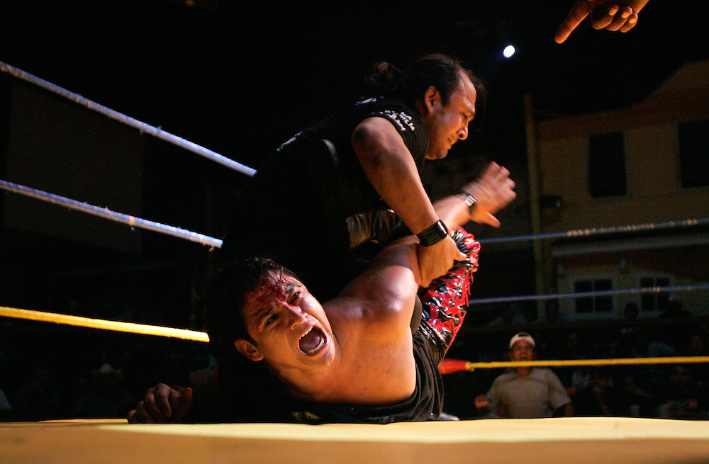 Corazon de Barrio cries out in pain as he is pinned by 666 during a match at the Tejano Saloon in Pharr.
