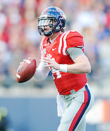 Ole Miss Rebels quarterback Bo Wallace (14) looks to pass against Mississippi State at Vaught-Hemingway Stadium in Oxford, Miss. on Saturday, November 29, 2014.