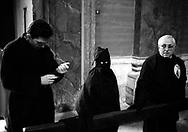 Roma 2001.Processione penitanziale  delle Confraternite Cristiane dalla Chiesa di San. Carlo al Corso fino alla Chiesa di San. Marcello al Corso che si svolge nel periodo della Quaresima..Arciconfraternita del SS. Crocifisso e Monte dei Morti.in Sessa Aurunca (Caserta) fondata nel 1575.Rome. Procession penitential of  the Christian Confraternity from the  church of S.Carlo al Corso  up to  the church  of  S. Marcello al Corso that takes place during Lent..http://www.sscrocifisso.com/..