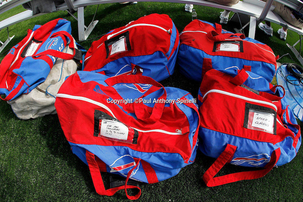Buffalo Bills equipment bags line the area behind the bench during the NFL regular season week 3 football game against the New England Patriots on September 26, 2010 in Foxborough, Massachusetts. The Patriots won the game 38-30. (©Paul Anthony Spinelli)