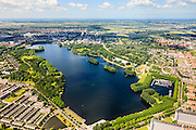 Nederland, Noord-Holland, Amsterdam, 14-06-2012; Overzicht van de Sloterplas met de wijken Slotervaart (onder), Osdorp en Geuzenveld (rechts). Haarlemmermeer aan de horizon..Overview of Slotervaart (bottom) and Osdorp and Geuzeveld (r), residential areas of Amsterdam-West. Recreational lake Sloterplas in the middle of the picture. ..luchtfoto (toeslag), aerial photo (additional fee required).foto/photo Siebe Swart