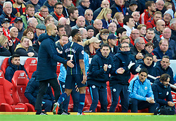 LIVERPOOL, ENGLAND - Sunday, October 7, 2018: Manchester City's manager Pep Guardiola consoles Raheem Sterling after substituting the player during the FA Premier League match between Liverpool FC and Manchester City FC at Anfield. (Pic by David Rawcliffe/Propaganda)