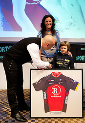 Milan Erzen, manager of Cycling team KK Adria Mobil with an auction cheque and jersey of Lance Armstrong for Petra and Nal Jure Robic, wife and son of rider died Jure Robic during Sporto  2010 Gala Dinner and Awards ceremony at Sports marketing and sponsorship conference, on November 29, 2010 in Hotel Slovenija, Portoroz/Portorose, Slovenia. (Photo By Vid Ponikvar / Sportida.com)