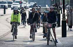 © Licensed to London News Pictures. 04/05/2020. London, UK. Cyclists make their way through Parliament Square in London during the morning commute. Government is set to announce measures to easy lockdown, which was introduced to fight the spread of the COVID-19 strain of coronavirus. Photo credit: Ben Cawthra/LNP