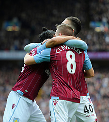 Aston Villa's Tom Cleverley celebrates with Aston Villa's Jack Grealish and Aston Villa's Kieran Richardson  - Photo mandatory by-line: Joe Meredith/JMP - Mobile: 07966 386802 - 09/05/2015 - SPORT - Football - Birmingham - Villa Park - Aston Villa v West Ham United - Barclays Premier League
