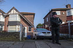 © Licensed to London News Pictures . 18/02/2013 . Salford , UK . A policeman guards the scene in front of a house on Light Oaks Road , Salford . Police have today (18th February) announced they are launching a murder investigation after the discovery of the dead body of a 19-year-old man with multiple injuries yesterday (17th February) evening . Photo credit : Joel Goodman/LNP