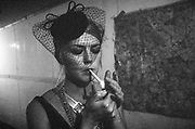 Lady lighting a cigarette