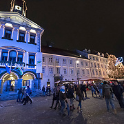 LJUBLJANA, SLOVENIA - DECEMBER 02:  Locals and tourists walk in front of the Town Hall decorated with Christmas lights on December 2, 2017 in Ljubljana, Slovenia. The traditional Christmas market and lights will stay until 1st week of January 2018.  (Photo by Marco Secchi/Getty Images)
