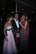 Emma Holloway, Lord Biddulph and Mrs. Karen Liddle-Grainger. The  Royal Caledonian Ball in aid of The Royal Caledonian Ball Trust held at The Grosvenor House Hotel, Park Lane, London W1.  28  April 2005. ONE TIME USE ONLY - DO NOT ARCHIVE  © Copyright Photograph by Dafydd Jones 66 Stockwell Park Rd. London SW9 0DA Tel 020 7733 0108 www.dafjones.com