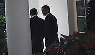 President Barack Obama and Iraq Prime Minister Maliki talk after participating  in a joint news conference in the Rose Garden of the White House on July 22, 2009.  Photograph by Dennis Brack