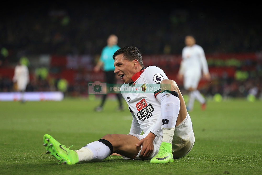 11 February 2017 - Premier League - Manchester United v Watford - Jose Holebas of Watford reacts after over-stretching for the ball - Photo: Marc Atkins / Offside.