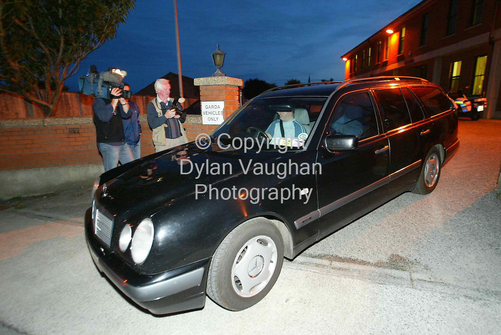 1/9/2004..The body being removed by the hearse at Tramore Garda Station yesterday evening...Picture Dylan Vaughan