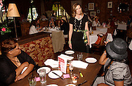 Lisa Herd of Oakwood (center) models some clothes from Talbott's during the Derby Day Brunch, benefiting the Kettering Wellness Center, held at the Brio Tuscan Grille in the Greene, Saturday, May 1, 2010.
