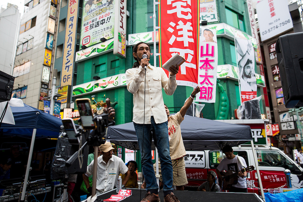TOKYO, JAPAN - JULY 5 : Yohei Miyake, Japanese musician and independent candidate for July's House of Councillors elections, delivers a campaign speech outside Shinjuku Station on July 5, 2016, Tokyo, Japan. (Photo: Richard Atrero de Guzman/NUR Photo)