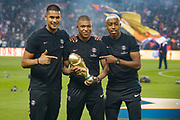PSG Alphonse Areola, Kylian Mbappe and Presnel Kimpembe hold the world cup trophy prior to the French championship L1 football match between Paris Saint-Germain (PSG) and Caen on August 12th, 2018 at Parc des Princes, Paris, France - Photo Geoffroy Van der Hasselt / ProSportsImages / DPPI