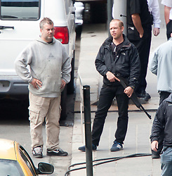 """Day two of filming. A man with a shotgun on the set of the movie """"World War Z"""" being shot in the city centre of Glasgow. The film, which is set in Philadelphia, is being shot in various parts of Glasgow, transforming it to shoot the post apocalyptic zombie film.."""