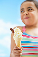 Girl (7-9 years) holding icecream focus on icecream