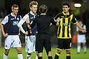 The ref talks to Millwall FC midfielder George Saville following a hard challenge on Burton Albion defender Tom Flanagan during the Sky Bet League 1 match between Burton Albion and Millwall at the Pirelli Stadium, Burton upon Trent, England on 1 December 2015. Photo by Aaron Lupton.