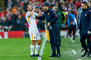 AS Roma midfielder Alessandro Florenzi (24) takes a drink while taking instructions from AS Roma manager Eusebio Di Francesco  during the Champions League semi final leg 1 of 2 match between Liverpool and Roma at Anfield, Liverpool, England on 24 April 2018. Picture by Simon Davies.