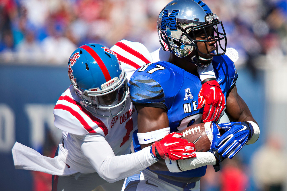 MEMPHIS, TN - OCTOBER 17:  Tevin Jones #87 of the Memphis Tigers is tackled by Tony Bridges #1 of the Ole Miss Rebels at Liberty Bowl Memorial Stadium on October 17, 2015 in Memphis, Tennessee.  The Tigers defeated the Rebels 37-24.  (Photo by Wesley Hitt/Getty Images) *** Local Caption *** Tevin Jones; Tony Bridges