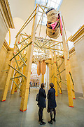 Phyllida Barlow's new work 'dock' is the new installation, which fills Tate Britain's Duveen Galleries. Here untitled:dock:hungprongsplastercoils.  It has been created as part of the annual Tate Britain Commission, in which a leading contemporary artist is invited to develop a work inspired by Tate's Collection. Phyllida Barlow has worked for over four decades with inexpensive, everyday materials to create large sculptural installations and bold and colourful three-dimensional collages. Tate Britain, Millbank, London, UK 31 March 2014.   Guy Bell Photography, 07771 786236, guy@gbphotos.com