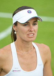 LONDON, ENGLAND - Wednesday, June 25, 2014: Martina Hingis (SUI) is forced to wear a cap from the souvenir shop after her own was ruled out by the umpire for breaching Wimbledon's strict brand guidelines during the Ladies' Doubles 1st Round match on day three of the Wimbledon Lawn Tennis Championships at the All England Lawn Tennis and Croquet Club. (Pic by David Rawcliffe/Propaganda)