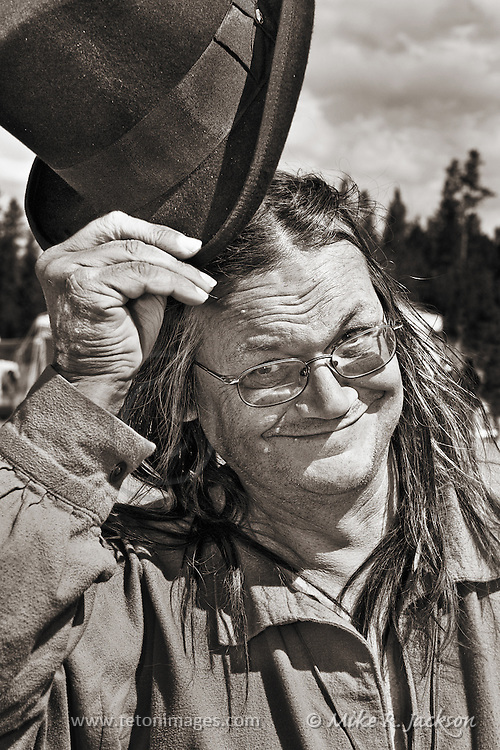 Jovial Trader tipping his top hat at the West Yellowstone Rendezvous and Trader Fair.