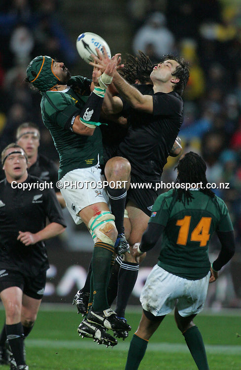 All Blacks Conrad Smith competes with Victor Matfield for a high ball. Philips Tri Nations, All Blacks vs South Africa, Westpac Stadium, Wellington, New Zealand, Saturday 5 July 2008. Photo: John Cowpland/PHOTOSPORT