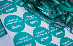 © Licensed to London News Pictures. 09/03/2016. London, UK.  Stickers and lanyards in support of junior doctors are handed out on a picket at St George's hospital in Tooting. Junior doctors are continuing their strike action after the government said it intended to impose a new employment contract. Photo credit: Peter Macdiarmid/LNP
