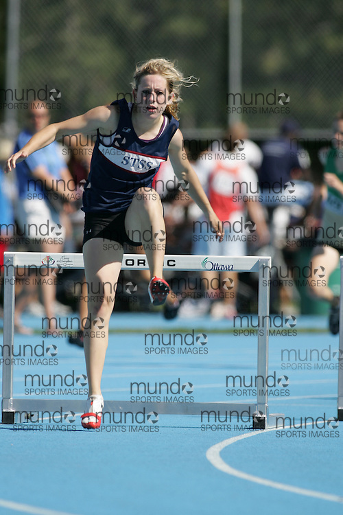 Kirsten Mooney competing in the senior girls 400m hurdles heat at the 2007 OFSAA Ontario High School Track and Field Championships in Ottawa.