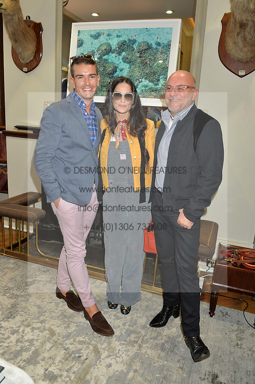 Left to right, GRAY MALIN, DEMI MOORE and ERIC BUTERBAUGH at a private view of photographs by Gray Malin 'Beaches' held at Huntsman, 11Savile Row, London on 20th June 2016.